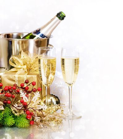 Champagne and Gifts.New Year Celebration.Isolated on white photo