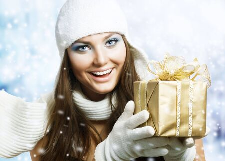 Beautiful Happy Girl with Christmas Gift.Snow Stock Photo - 8392257