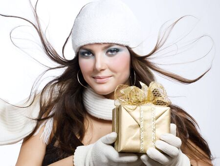white glove: Beautiful Happy Girl with Christmas Gift.Snow