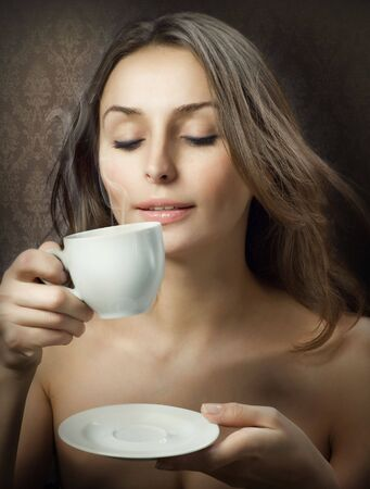 Beautiful Woman Drinking Coffee photo