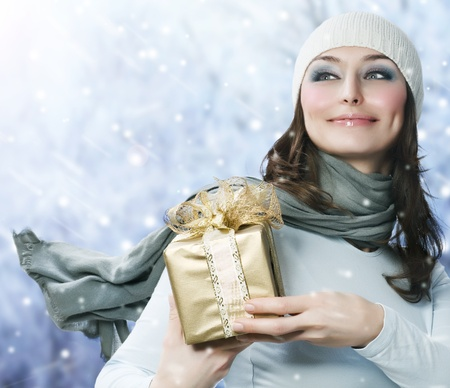 Beautiful Young Woman with Christmas Gift Stock Photo - 8253222