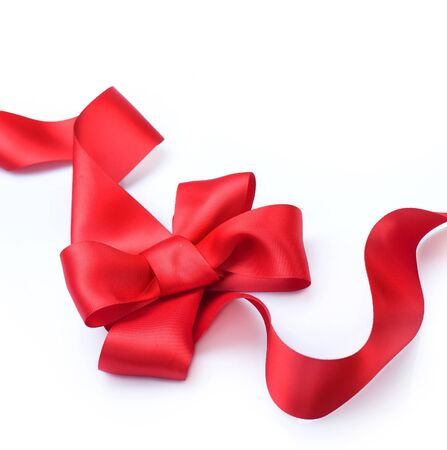 Red satin gift bow. Ribbon. Isolated on white Stock Photo - 8375020