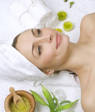 facial cleansing: Spa salon.beautiful young woman Stock Photo