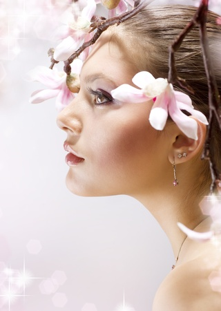magnolia flower: Beautiful Spring Girl with flowers