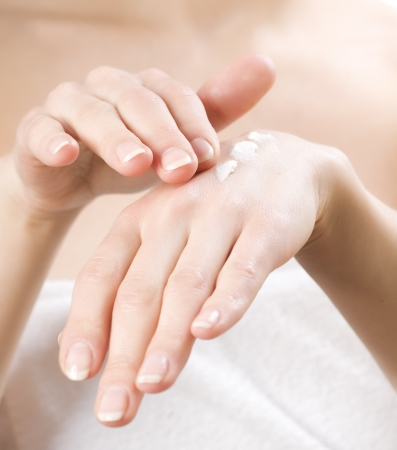 apply: Female applying moisturizer to her Hands after bath.Skincare concept Stock Photo