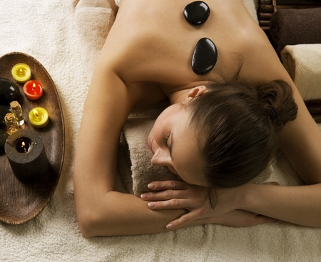 hot girl lying: Spa.Stone massage.Dayspa Stock Photo