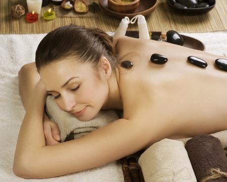 Spa Woman.Hot Stones Massage.Beauty salon photo