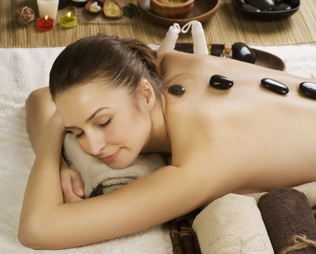 Spa Woman.Hot Stones Massage.Beauty salon photo