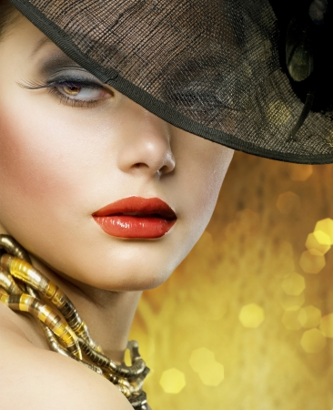 Beautiful Woman over luxury gold background Stock Photo - 9023623