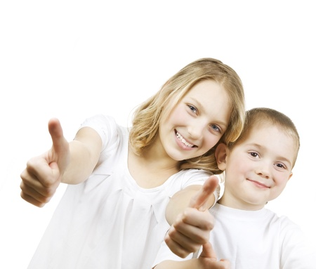 kids hugging: Happy Kids Sister and Brother with thumbs up.Isolated on a white background