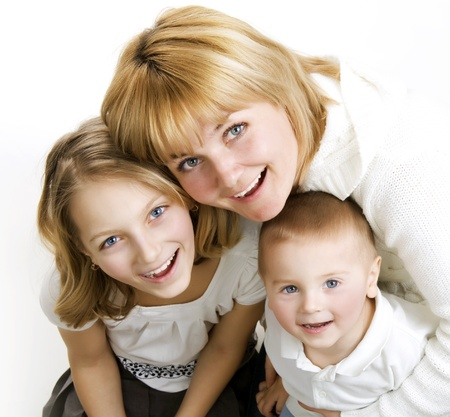 Mother with kids. Happy Smiling Family over white Фото со стока