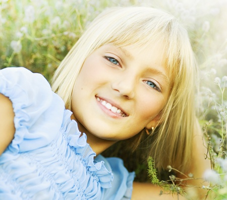 blue eyed: Beautiful Happy spring Little Girl outdoor  Stock Photo