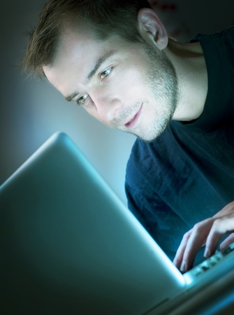 Young Man With Laptop Stock Photo - 9378930