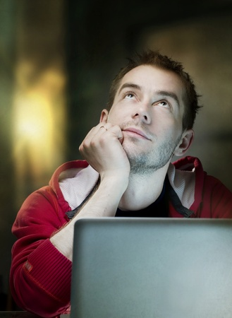 using laptop: Young Man With Laptop