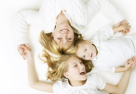 women children: Mother with kids. Happy Smiling Family over white Stock Photo