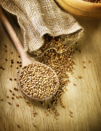 buckwheat: Buckwheat groats in a wooden spoon