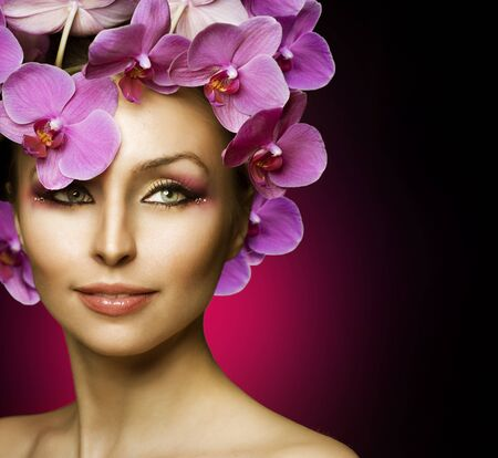 Beautiful Spring Girl With Orchid flowers over black photo