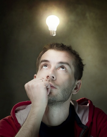 Young Man Having an Idea. Light bulb above his head Stock Photo - 9378853