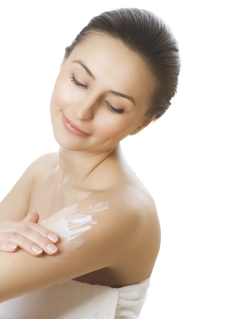 bath cream: Beautiful Young Woman applying moisturizer. Spa concept Stock Photo