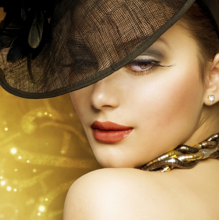 Beautiful Woman over luxury golden background photo