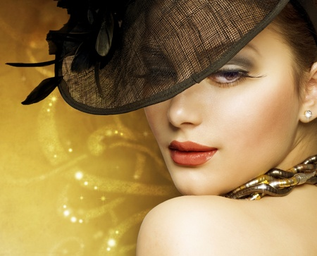 Beautiful Woman over luxury gold background photo