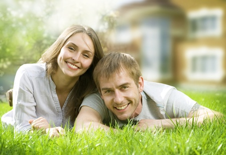 Happy Couple near their Home. Smiling Family outdoors photo