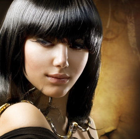 beautiful brunette. egyptian style. hairstyle photo