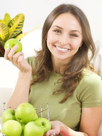 concep: Happy Young Woman with apples. Healthy eating concep