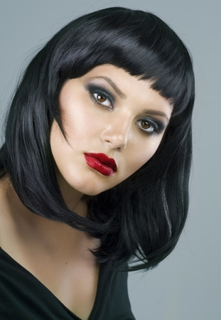 Brunette Extreme makeup. Haircut photo