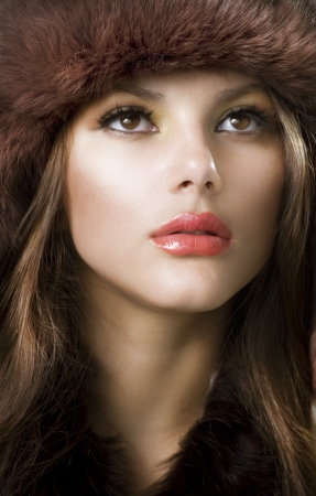 Beautiful Young Woman wearing Fur Hat. Winter Style photo