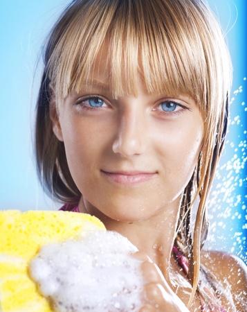 Teenage Girl Taking a Shower. Washing Hair photo