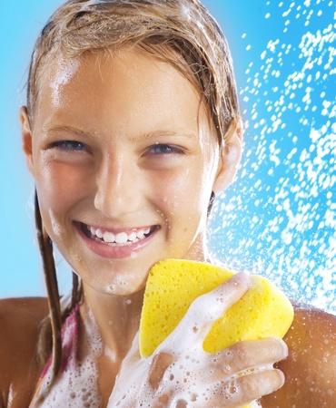 Teenage Girl Taking a Shower. Bathing. Washing photo