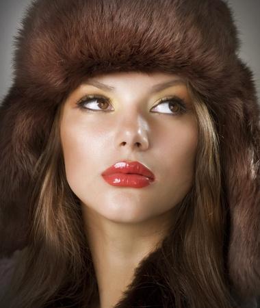 russian woman: Beautiful Young Woman wearing Fur Hat. Winter Style Stock Photo