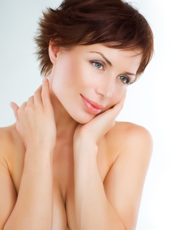 Beautiful Young Woman touching her Face. Skincare. Perfect Skin Stock Photo - 10679550