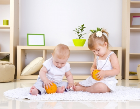 Toddlers Playing at home. Kids  Stock Photo