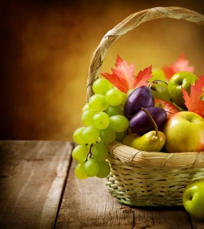harvest basket: Organic ripe fruits  Stock Photo