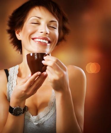 woman drinking tea: Beautiful Stylish Girl Drinking Coffee