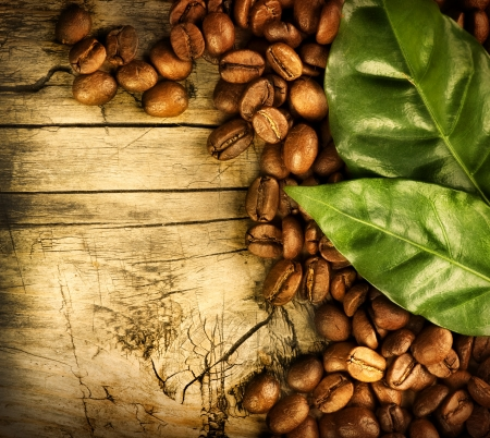 brewed: Coffee Beans over Wood Background  Stock Photo