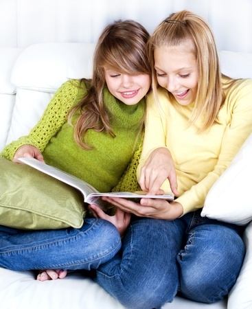 schoolgirls: Teenage Girls reading fashion Magazine  Stock Photo