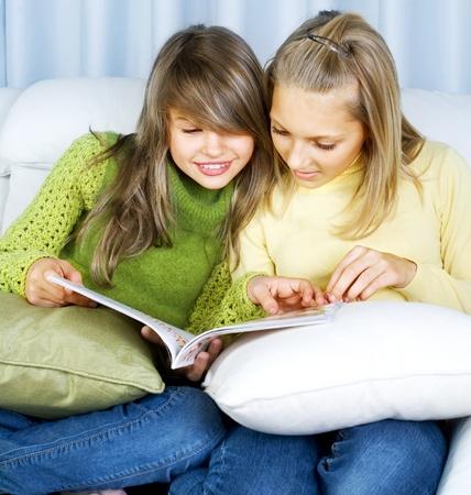 school teens: Teenage Girls reading fashion Magazine  Stock Photo