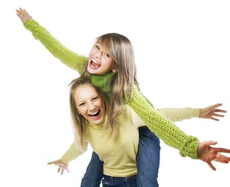 young teen girl: Teenage Girls Having Fun. Friends. Emotions  Stock Photo