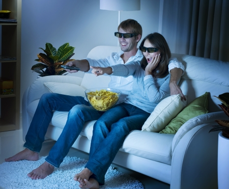 home theatre: Family watching 3D film on TV