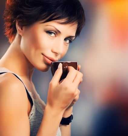 latte art: Beautiful Girl With Cup of Coffee  Stock Photo