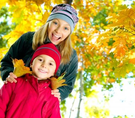 autumn family: Happy Kids in Autumn Park
