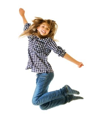 Girl jumping of joy over white background photo