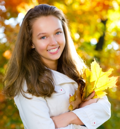schoolgirls: Beautiful Teenage Girl in Autumn Park Stock Photo