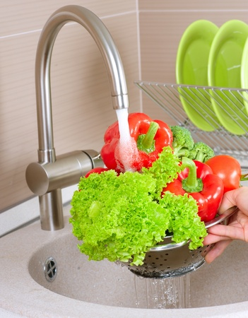 food hygiene: Fresh Vegetables Washing  Stock Photo