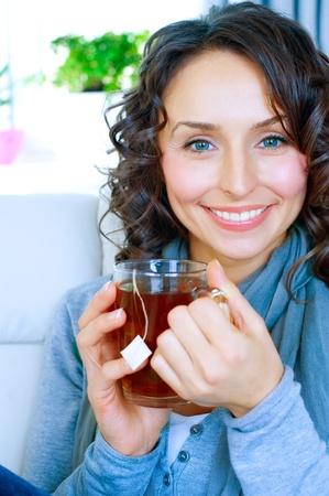 alternative medicine: Beautiful Young Woman drinking hot tea