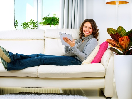 modern sofa: Young Woman With Tablet PC At Home  Stock Photo