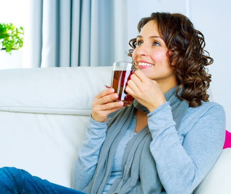 take medicine: Beautiful Young Woman drinking hot tea